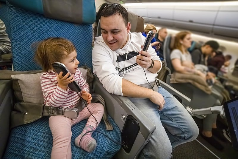 baby with own seat on flight