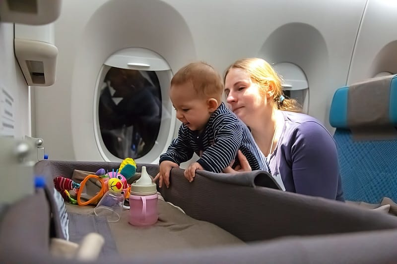 baby with toy in flight