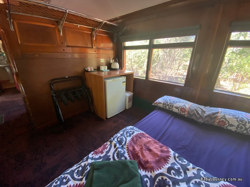 Railway Carriages Undara Experience living area, bed setup